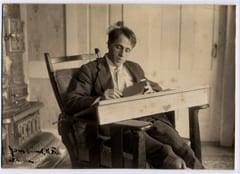 Robert Frost at his desk in Franconia